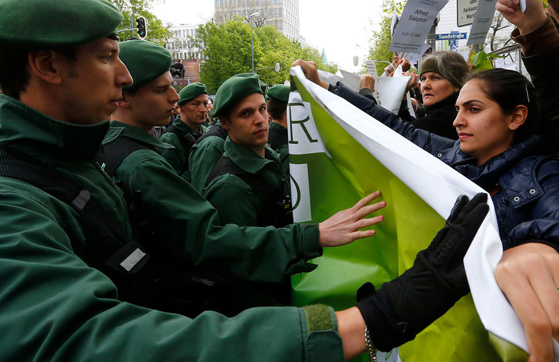 . Police block protesters outside the courthouse, where the trial against Beate Zschaepe, a member of the neo-Nazi group National Socialist Underground (NSU), started in Munich May 6, 2013. The surviving member of the NSU blamed for a series of racist murders that scandalized Germany and shamed its authorities goes on trial on Monday in one of the most anticipated court cases in recent German history. The trial in Munich will focus on 38-year-old Zschaepe, who is charged with complicity in the murder of eight Turks, a Greek and a policewoman between 2000-2007, as well as two bombings in immigrant areas of Cologne, and 15 bank robberies.  REUTERS/Kai Pfaffenbach