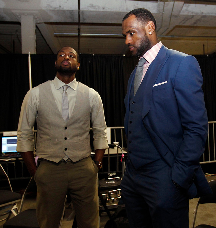 . Miami Heat\'s Dwyane Wade and LeBron James wait in the hall after Game 6 of the NBA Finals basketball game against the Dallas Mavericks Sunday, June 12, 2011, in Miami. The Mavericks won 105-95 to win the series. (AP Photo/Lynne Sladky)