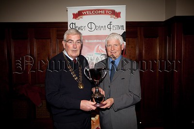Newry  Drama festival Chairperson Gerry McAnulty is presented with a New Trophy by Louis Boyle in memory of his late sister Anne who was a long standing and valued committee member. R1551009