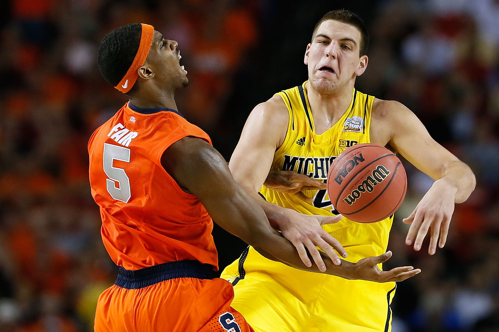 . ATLANTA, GA - APRIL 06:  C.J. Fair #5 of the Syracuse Orange fights for a rebound in the secon dhalf against Mitch McGary #4 of the Michigan Wolverines during the 2013 NCAA Men\'s Final Four Semifinal at the Georgia Dome on April 6, 2013 in Atlanta, Georgia.  (Photo by Kevin C. Cox/Getty Images)
