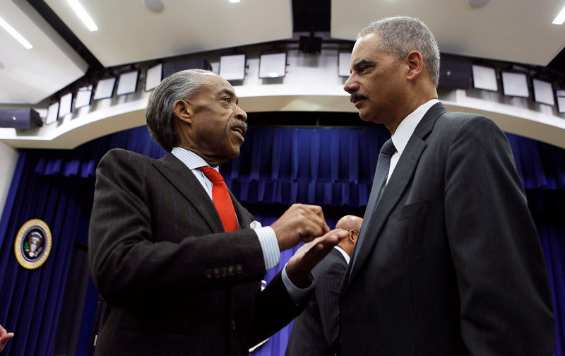 . Television commentator and anchor Rev Al Sharpton (L) talks with U.S. Attorney Eric Holder before U.S. President Barack Obama unveils a series of proposals to counter gun violence during an event at the  White House in Washington, January 16, 2013. Vice President Joe Biden delivered his recommendations to Obama after holding a series of meetings with representatives from the weapons and entertainment industries as requested by the president after the December 14 school shooting in Newtown, Connecticut, in which 20 children and six adults were killed. REUTERS/Larry Downing