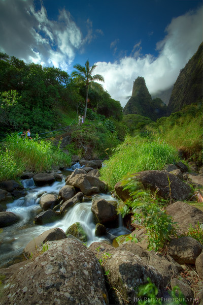 "Looks like the set of ""Lost"". Nice view of the Iao Needle with lush foliage and a rushing stream."