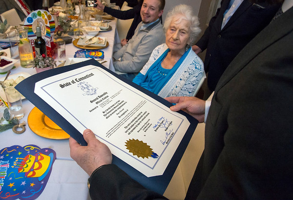 01/10/20 Wesley Bunnell | StaffrrAnne Durant , who turned 100 on January 2nd, celebrated her 100th birthday with a party at Belvedere Restaurant on Friday evening with special guests State Senator Gennaro Bizzarro and Lt. Gov. Susan Bysiewicz. Durant looks up as Senator Bizzarro reads a proclamation from the state honoring her birthday.