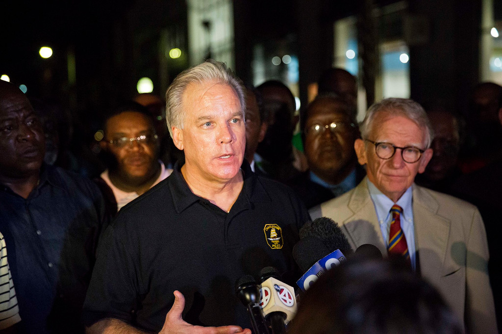 . Charleston Police Chief Gregory Mullen, center, addresses the media while joined by Mayor Joseph Riley, right, down the street from the Emanuel AME Church early Thursday, June 18, 2015 following a shooting Wednesday night in Charleston, S.C. (AP Photo/David Goldman)