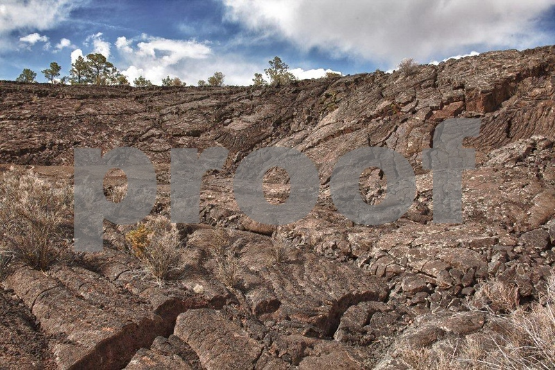 Within the El Malpais National Monument, this lava flow came from the McCartys Crater 3,000 years ago. Stop #5 is called the Natural Amphitheater which is a wall of lava that forms a circular ridge around a relatively flat bottom called an inflation ridge