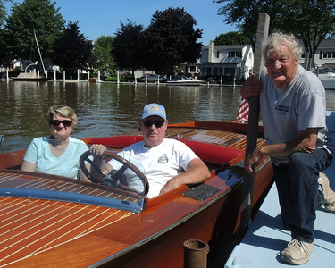 June 15, 2018, Vermilion visitors from E. Windsor NJ here gets a ride in a 1927 Dodge Water Car boat thanks to Janet Waggoner.