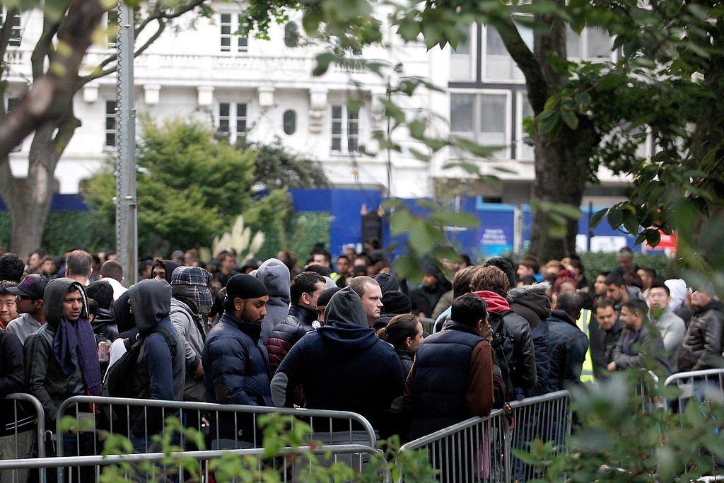 . The queue to buy the first iPhone 5S and iPhone5C\'s in the UK, snakes around the block and into Cavendish Square park, outside the Apple store Regent Street on September 20, 2013 in London, England.  (Photo by Mary Turner/Getty Images)