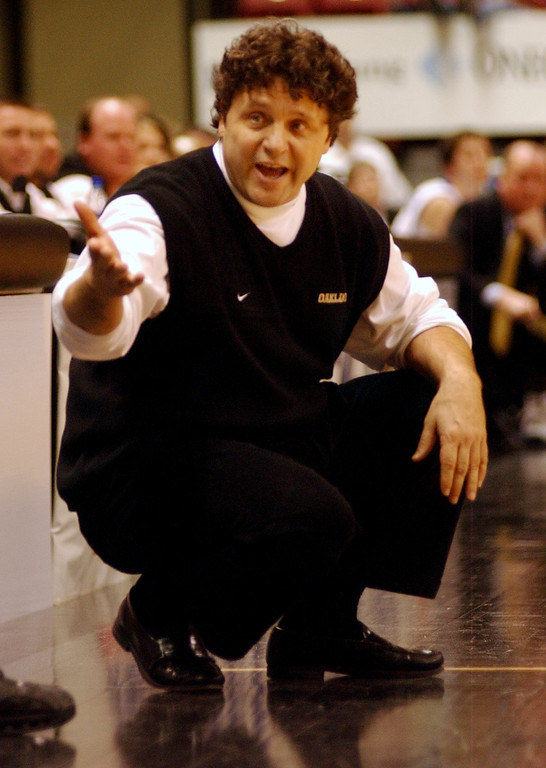 . Oakland University men\'s basketball head coach Greg Kampe gives instruction to his team as they played UMKC during first half action, Saturday, March 5, 2005, at the John Q. Hammons Arena in Tulsa, Okla.