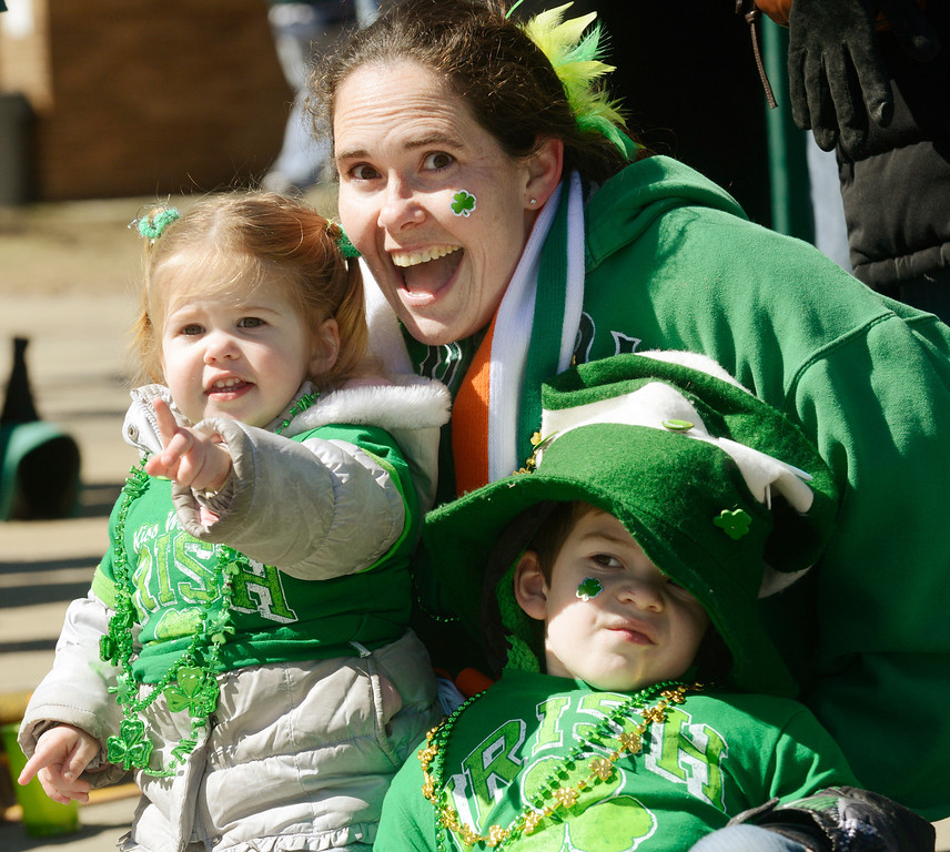 . Maribeth Joeright/MJoeright@News-Herald.com Nicole McHale of Moreland Hills watches the 147th annual St. Patrick\'s Day parade with her children Lilly, 1, and Mikey, 4, March 17, 2014.