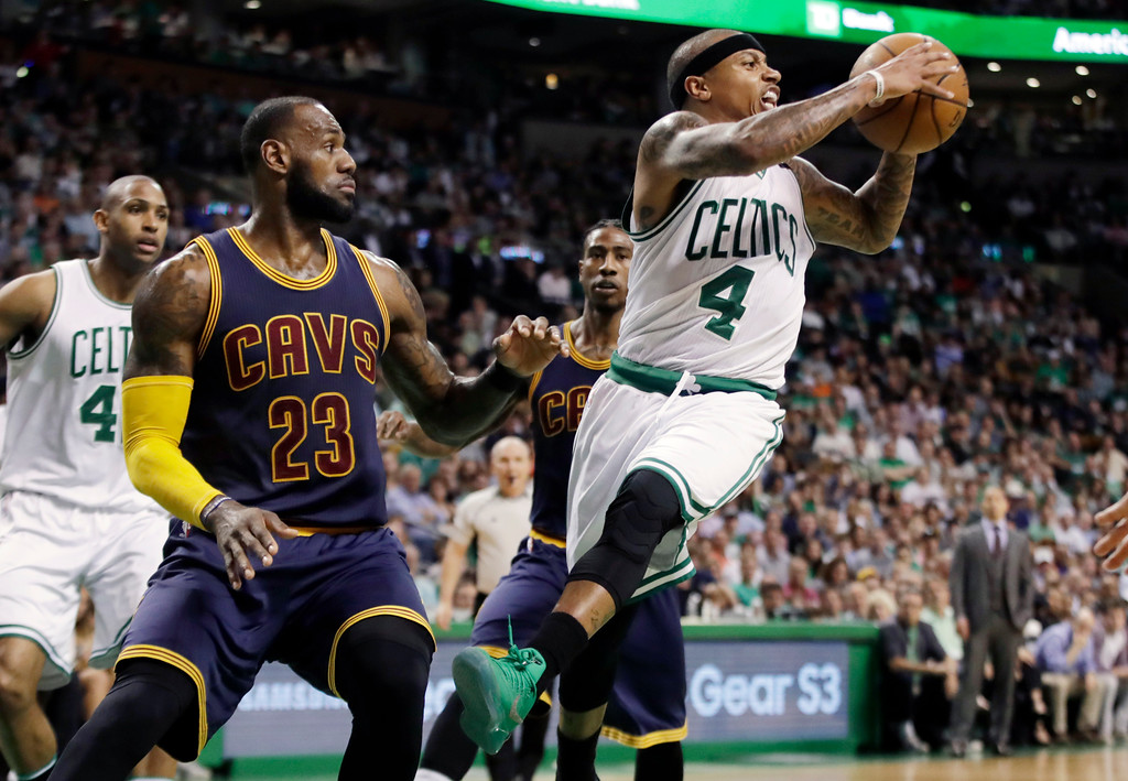 . Boston Celtics guard Isaiah Thomas (4) passes away from the defense of Cleveland Cavaliers forward LeBron James (23) during the second quarter of Game 2 of the NBA basketball Eastern Conference finals,, Friday, May 19, 2017, in Boston. (AP Photo/Elise Amendola)