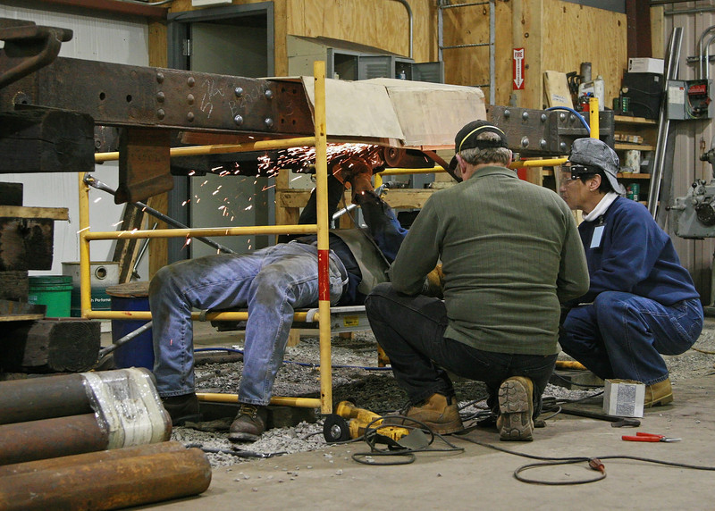 .Working under the locomotive frame to cut away badly deteriorated parts of the frame.  This was difficult and tedious work despite being able to lay down on the job. October 2007