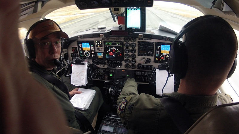 "HOW GOOD DO YOU WANT IT? - 7 February 2013  Cockpit Photo Just Prior to Leaving Adak Alaska in November 2011  ""How good do you want it?"" I asked this question about 30 years ago when I started my first aviation training course, navigator training with the US Air Force (USAF). I was a recent graduate from university, having performed relatively well the last couple of years. Navigator training was the start of my professional career and I thought to myself, ""I wonder how good I could have it?"" Since I hadn't done any flying before, and certainly hadn't done any USAF training like this before, I had no idea what to expect. I didn't know if I could do well. I didn't know if it took incredible efforts simply to be mediocre. I had no idea; it was all new to me. Still, I considered this question for a while before my training started.  Eventually, I answered the question. I wanted to see how well I could possibly do, which meant putting in my best possible effort no matter what. I had no idea how good I could be, so I thought: ""...let's see how good I could be if I tried has hard as I could.""  This wasn't really a specific goal like ""graduating number one"", or ""not failing any tests"", or getting ""out-standings"" on flight evals. But it was still a commitment, a daily commitment, to be solely focused on training, to do my best no matter what.  With that commitment, answers to living arrangements came into focus. Instead of renting near my classmates with their added distractions, I picked an apartment off the beaten path where it was nice and quiet. Instead of spending a lot of time and money trying to make this little place a mini palace, I considered it my monastery. It was cheaply furnished to keep costs down. I didn't buy a TV or get cable. Why have it since my TV time would be spent studying? I also got the most basic kitchen utensils and bathroom supplies. Except for my little bed and a desk to study at, I didn't buy anything. No frills was the best way to describe my new home.  When training started, that was all I did: I trained. I lived, ate, slept, and dreamed navigator training. I read, and read, and read some more. I answered all of the practice questions they gave me. I made my own practice questions to practice even more. I made my own little tests and practiced taking them under time limits, trying to simulate testing conditions. I made my own training exercises, trying to emulate the exercises I would undertake during real flight evals. While practicing these exercises, I pretended I had bad weather making me re-plan and compensate in-flight. I imagined scenarios in which pilots wouldn't follow direction, flying incorrect headings, forcing me to find their errors, then take steps to correct the mistakes. My goal was to be as prepared as I could be by imagining and then practicing every possible scenario I could think of. I even developed a very disciplined process for taking tests, answering the questions, transferring the questions to the answer sheets, and all the while checking and triple checking I didn't inadvertently answer ""A"" instead of meaning ""C.""  This type of self-study was substantially more thorough than what I was tasked to do with assigned homework. Since I didn't have anything else to do--i.e. no distractions, no TV--I was consistent with this self-study throughout my navigator course. It paid off.  After seven months of training, I missed four total questions on academic tests, tying me for best academically in my class. Even after marking thousands of different multiple choice answers, none of the four were missed due to mis-marking an answer.  I did very well during my flight evals. All that self-study prepared me for those times when my flights didn't go as planned. As all experienced aviators know, no flight goes precisely as planned. Inevitably some re-planning is required. Being prepared becomes so important. What I didn't know then is a measure of an aviator's abilities can be shown by how elegantly they deal with these bumps. All that self-study allowed me to smoothly adjust to changes with minimal panic, which is exactly how I want things to roll nowadays, 30 years and thousands of flight hours later. As a result of all this, I was the best flier in my class.  Because of these scores, I graduated at the top of my class - probably my most important professional achievement. With a #1 graduate on my resume, doors opened that allowed me to get to my pilot wings, attend USAF Test Pilot School, and eventually the job I currently have, conducting experimental flight tests.  Looking backwards along the 30 year road that brings me to today, it's easy to see what's at the beginning of that road, asking that question, ""How good do you want it?"" Everything flowed from my answer, my direction, my choices, my commitment. Without that question, I'm not sure what would've happened. All bets would've been off, as they say.  Cheers Tom"