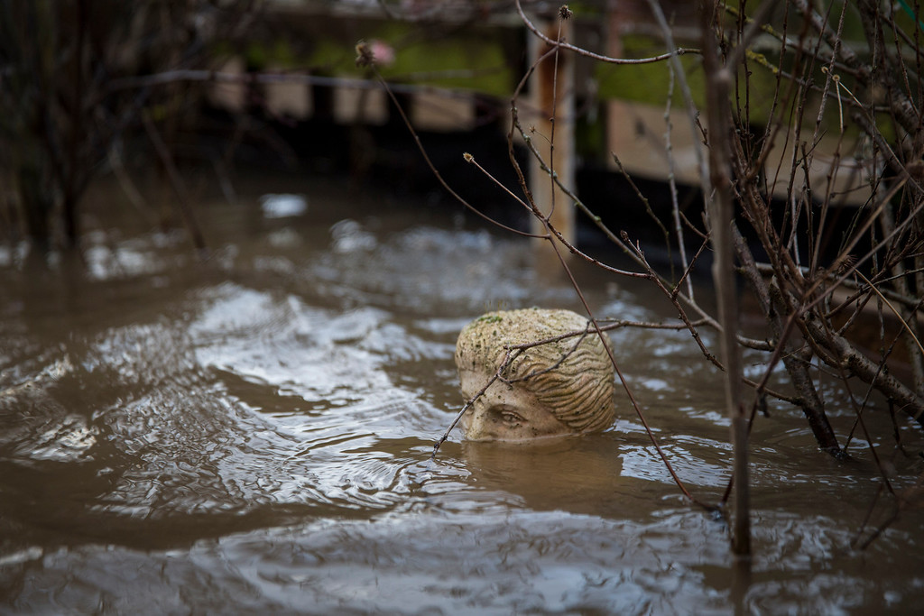 . A statue is submerged in flood water in the garden of a house on Diglis Avenue on February 12, 2014 in Worcester, England. The Environment Agency has issued flood warnings for dozens of areas along the River Severn. With heavier rains forecast for the coming week people are preparing for the water levels to rise. (Photo by Rob Stothard/Getty Images)