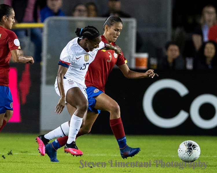 Crystal Dunn #19 of the USA and Maria Coto #3 of Costa Rica contest the ball
