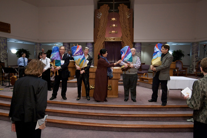 The four senior Torah scrolls, dressed in their new mantles, wait to be introduced to the new scroll