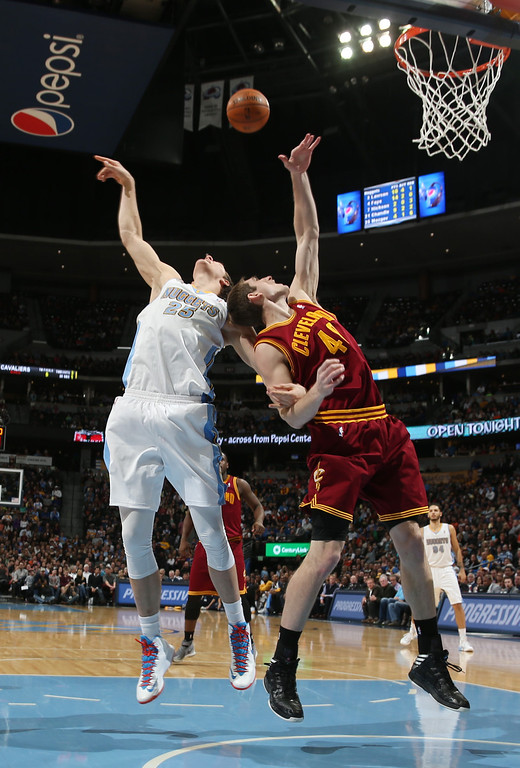 . Denver Nuggets center Timofey Mozgov, left, of Russia, battles for a rebound with Cleveland Cavaliers center Anderson Varejao, of Brazil, in the third quarter of the Cavaliers\' 117-109 victory in an NBA basketball game in Denver on Friday, Jan. 17, 2014. (AP Photo/David Zalubowski)
