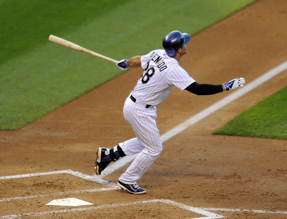. Colorado Rockies Nolan Arenado hits a two-run home run in the third inning of a baseball game against the Washington Nationals on Tuesday, July 22, 2014, in Denver. (AP Photo/Chris Schneider)