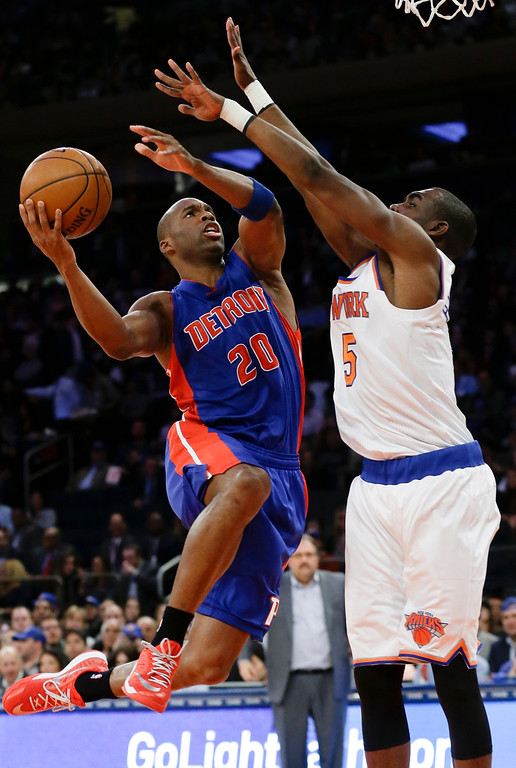 . Detroit Pistons\' Jodie Meeks (20) drives past New York Knicks\' Tim Hardaway Jr. (5) during the first half of an NBA basketball game Wednesday, April 15, 2015, in New York. (AP Photo/Frank Franklin II)