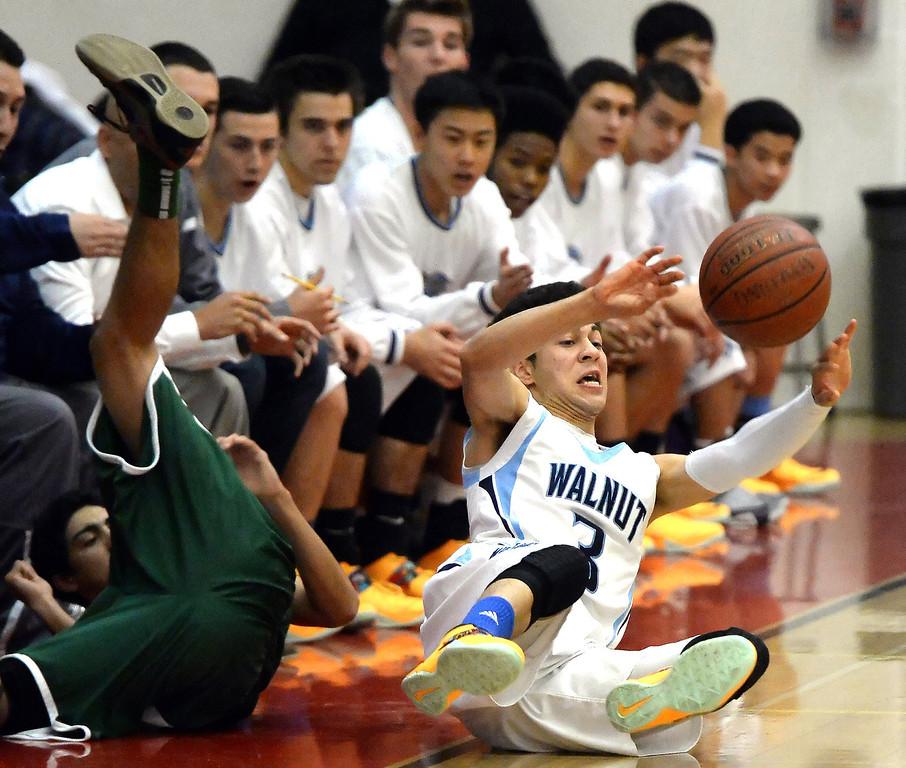 . Walnut\'s Rob Harrelson (C) (3) recovers a loose ball against Damien in the first half of the Glendora basketball tournament at Glendora High School in Glendora, Calif., on Friday, Dec. 13, 2013. Damien won 66-60.  (Keith Birmingham Pasadena Star-News)