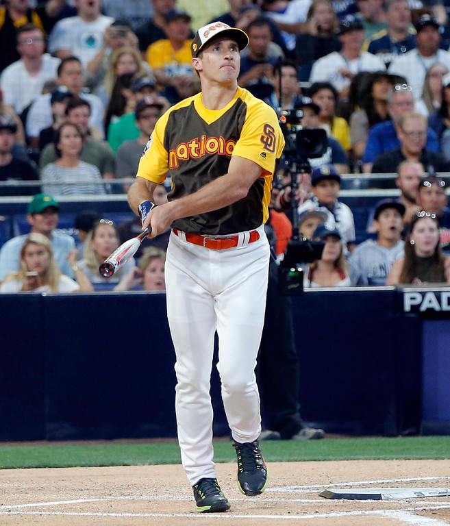 . New Orleans Saints quarterback Drew Brees hits a home run during the All-Star Legends & Celebrity Softball game, Sunday, July 10, 2016, in San Diego. (AP Photo/Lenny Ignelzi)