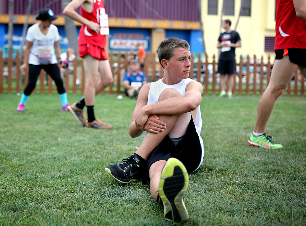 . Kyle Cullinane of Los Gatos stretches his legs before the start of the 42nd annual Wharf to Wharf race in Santa Cruz on Sunday. (Kevin Johnson -- Santa Cruz Sentinel)