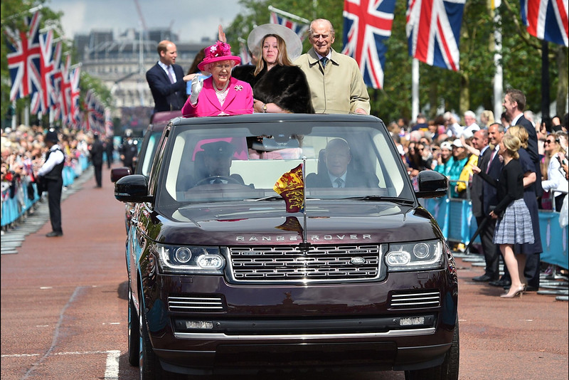 Ride with the Queen in a parade