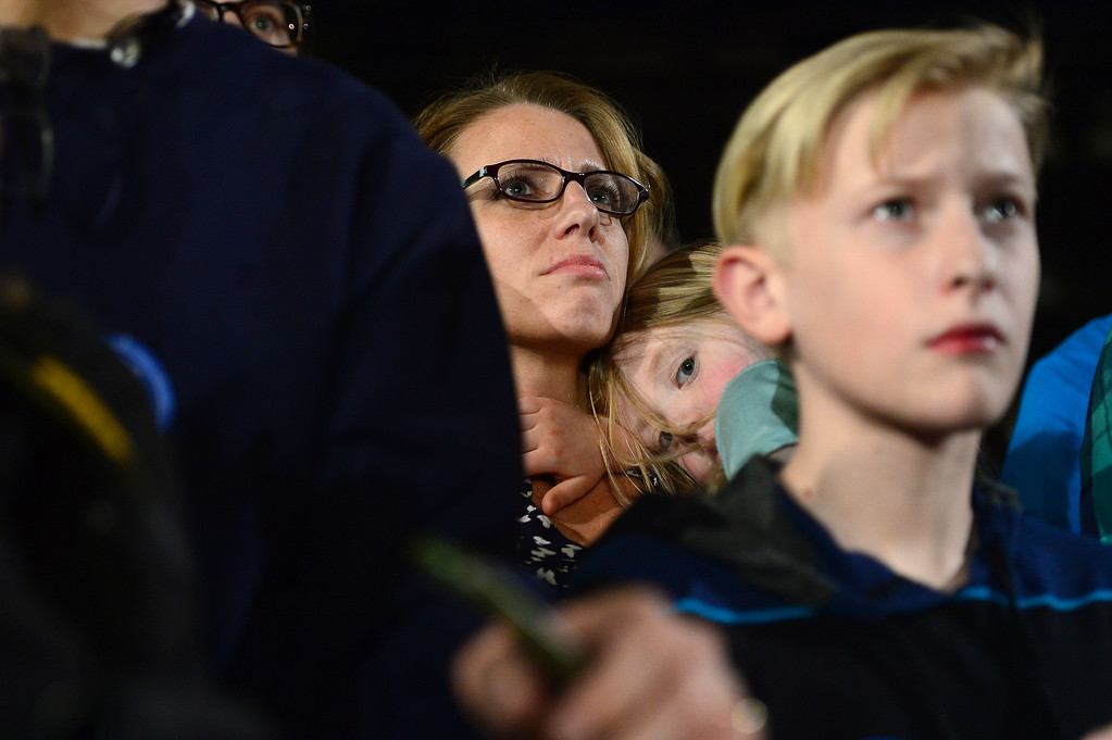 . A mother watches with her daughter as candidate for the Democratic nomination, U.S. Senator Bernie Sanders speaks during a rally at the Colorado Convention Center on February 13, 2016 in Denver, Colorado. U.S. Senator Sanders, one of the two remaining candidates biding for Democratic nomination for President, held a rally for Colorado to help push his message and also remind voters of the importance of voting in the upcoming caucuses for Colorado. (Photo by Brent Lewis/The Denver Post)