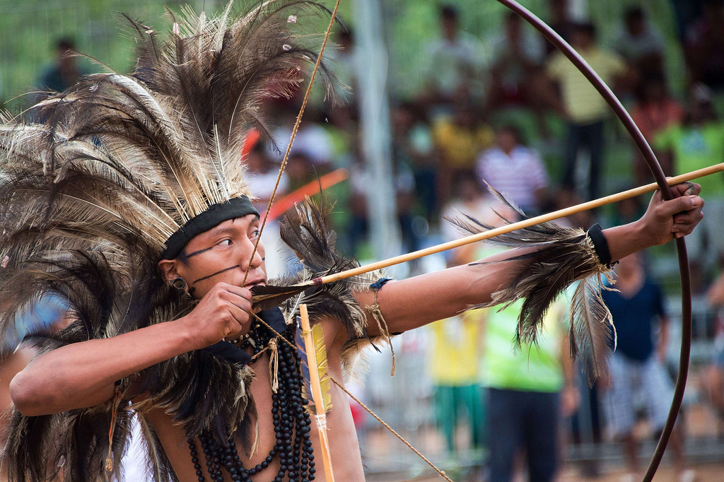 . A Brazilian indigenous man of the Terena tribe takes part in the bow and arrow competition during the XII International Games of Indigenous Peoples in Cuiaba, Mato Grosso state, Brazil on November 12, 2013. AFP PHOTO / Christophe SIMON/AFP/Getty Images