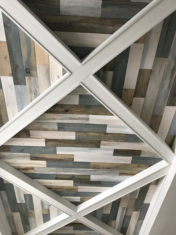 . A decorative ceiling composed of stained wood planks and created by designer Deb Metcalf is a special feature in the lower level of the 2018 Dream House. (Jean Bonchak)