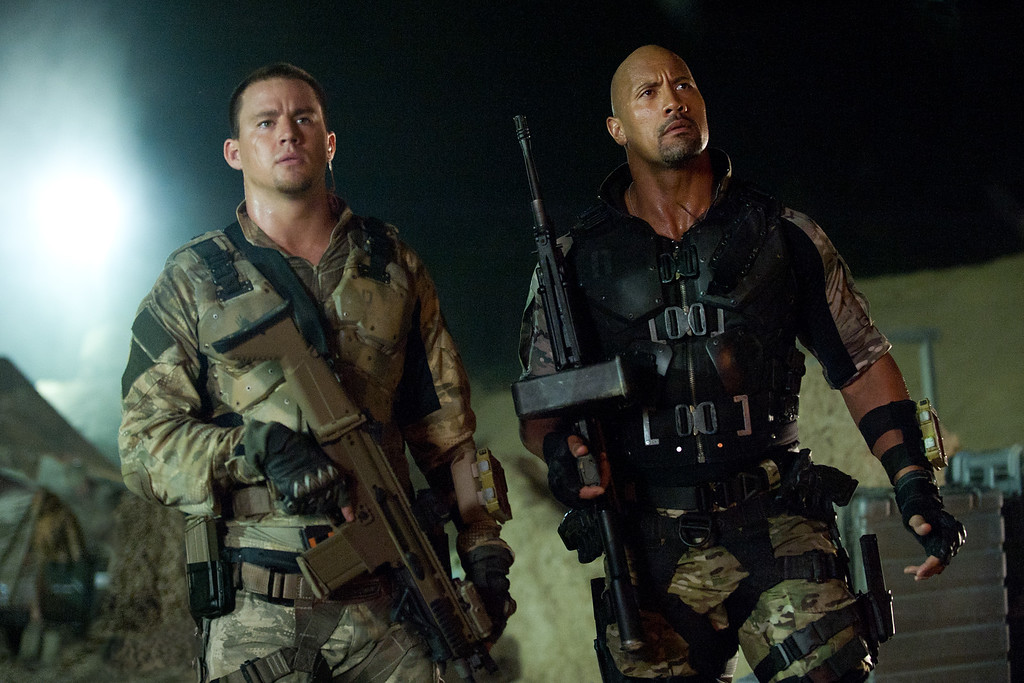 """. This film image released by Paramount Pictures shows Channing Tatum, left, and Dwayne Johnson in a scene from \""""G.I. Joe: Retaliation.\"""" (AP Photo/Paramount Pictures, Jaimie Trueblood)"""