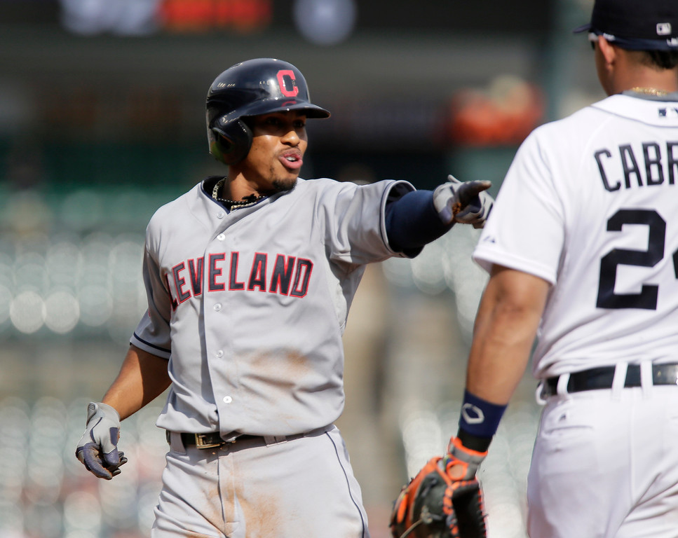 . Cleveland Indians\' Francisco Lindor, playing in his first major league game, points to Detroit Tigers first baseman Miguel Cabrera after tripping and falling down while rounding first base on a single in the ninth inning of a baseball game Sunday, June 14, 2015, in Detroit. Lindor was jokingly trying to blame Cabrera for falling. (AP Photo/Duane Burleson)