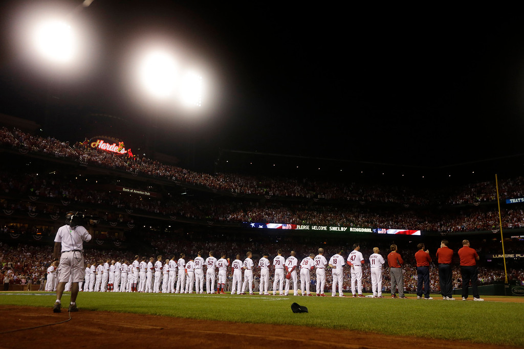 . The St. Louis Cardinals stand before the first inning of Game 1 of the National League baseball championship series against the Los Angeles Dodgers, Friday, Oct. 11, 2013, in St. Louis. (AP Photo/Jeff Roberson)
