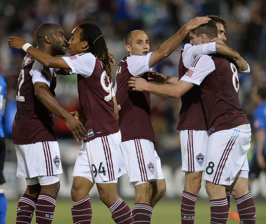 . The Rapids celebrated after Dillon Powers put in the fourth goal late in the second half. The Colorado Rapids defeated the Montreal Impact 4-1 Saturday night, May 24, 2014. (Photo by Karl Gehring/The Denver Post)