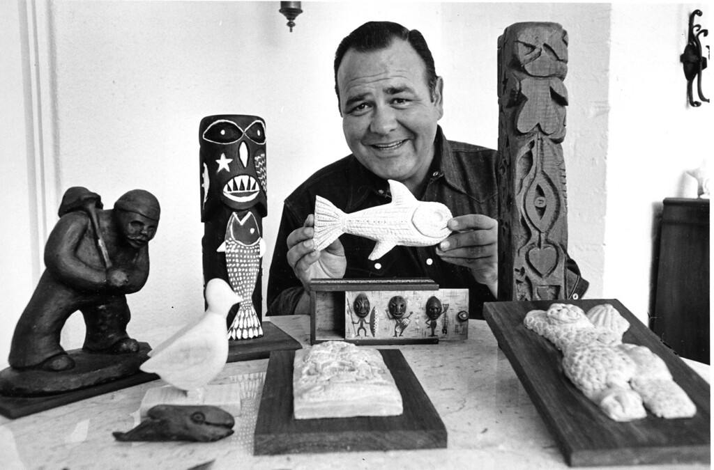 . Comedian Jonathan Winters poses with his carvings and sculptures at his home in Toluca Lake, Ca., on Sept. 1, 1966.  (AP Photo)