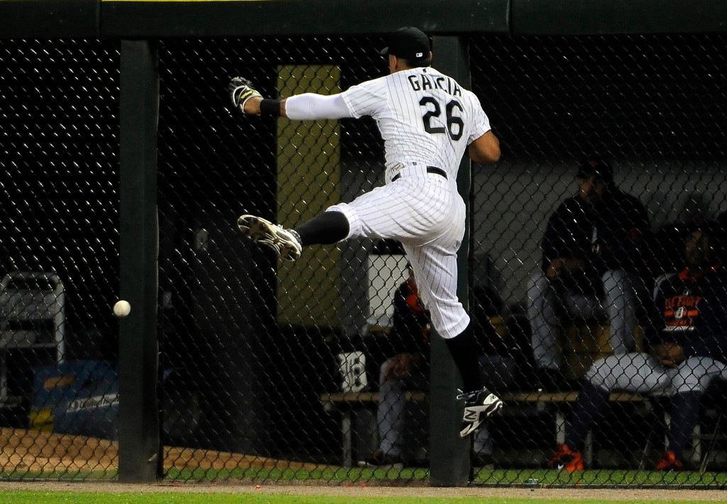 . Chicago White Sox right fielder Avisail Garcia (26) cannot make a catch on a RBI-double off the bat of Detroit Tigers\' J.D. Martinez during the eighth inning of a baseball game, Saturday, June 6, 2015, in Chicago. (AP Photo/David Banks)