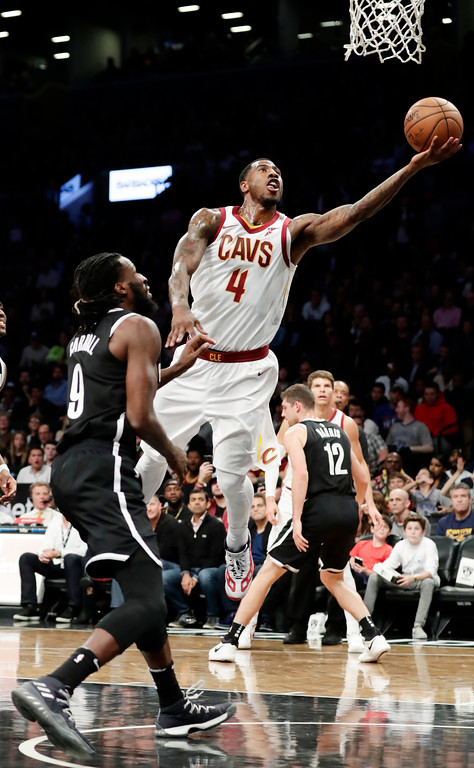 . Cleveland Cavaliers\' Iman Shumpert (4) drives past Brooklyn Nets\' DeMarre Carroll (9) during the first half of an NBA basketball game Wednesday, Oct. 25, 2017, in New York. (AP Photo/Frank Franklin II)