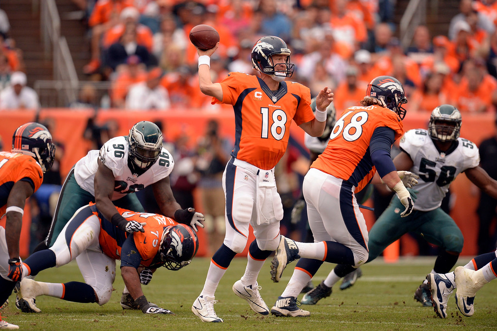 . Denver Broncos quarterback Peyton Manning (18) throws a quick pass to the side against the Philadelphia Eagles defense during the third quarter September 29, 2013 atSports Authority Field at Mile High in Denver . (Photo by John Leyba/The Denver Post)