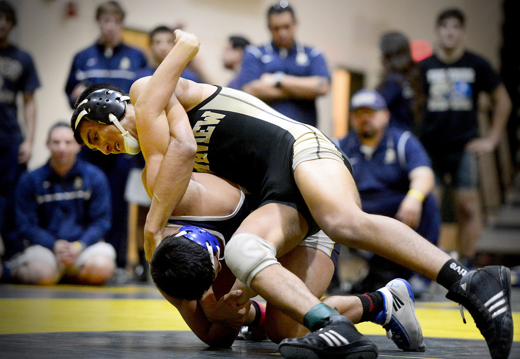 . Northview\'s Roger Arce defeats St. John Bosco\'s Ismael Sakez during the semifinals of the CIF-SS Division 2 wrestling finals at South Hills High School in West Covina Saturday night, February 8, 2014. Northview claimed championship after defeating Servite 42-30. (Photo by Sarah Reingewirtz/Pasadena Star-News)