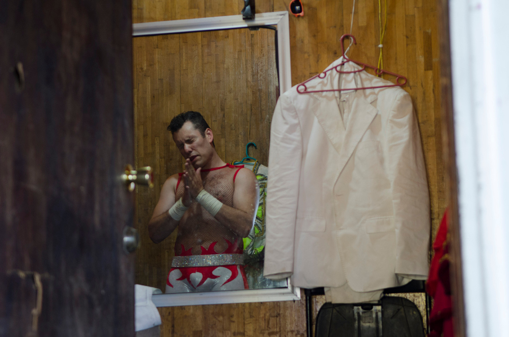 """Description of . In this June 22, 2014 photo Alex Fuentes prepares before a trapeze performance at the Fuentes Gasca Brothers Circus in Mexico City. Like many of the performers in the circus Fuentes was born and raised in the circus where his father was also an animal tamer and trainer. Fuentes and other performers at the circus fear that people won't come to a circus without animals. """"It's the circus, its magical and its what I've dedicated my life to since I was 15 and now they want to take away from me what I've desired my whole life,"""" said Fuentes, now 30. (AP Photo/Sean Havey)"""