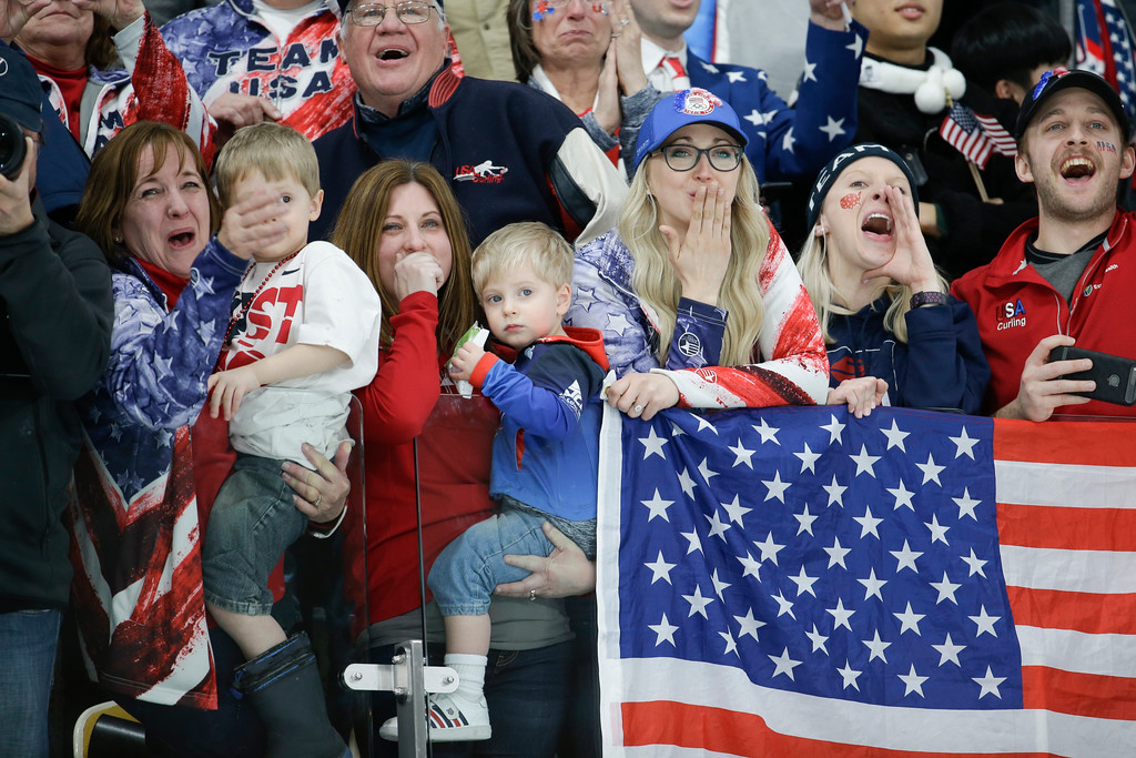 . United States\'s followers celebrate their team winning the men\'s final curling match against Sweden at the 2018 Winter Olympics in Gangneung, South Korea, Saturday, Feb. 24, 2018. (AP Photo/Natacha Pisarenko)