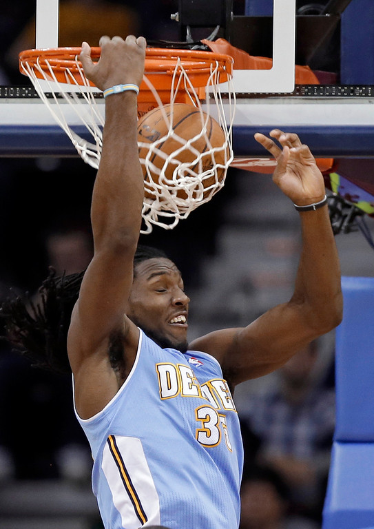 . Denver Nuggets\' Kenneth Faried dunks against the Cleveland Cavaliers in the second quarter of an NBA basketball game Saturday, Feb. 9, 2013, in Cleveland. (AP Photo/Mark Duncan)