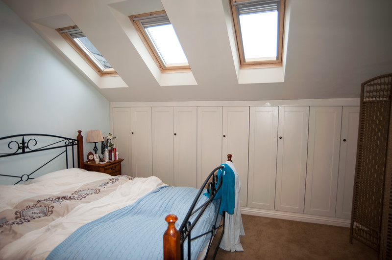 Wardrobs following the shape of attic room, shaker style doors