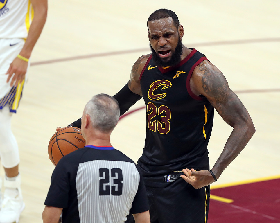 . Cleveland Cavaliers\' LeBron James argues a call with referee Jason Phillips during the first half of Game 4 of basketball\'s NBA Finals against the Golden State Warriors, Friday, June 8, 2018, in Cleveland. (AP Photo/Carlos Osorio)