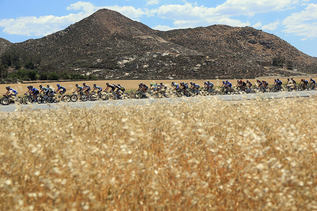 . The peloton passes through a wheat field during Stage Two of the 2013 Amgen Tour of California from Murrieta to Palm Springs on May 13, 2013 in Hemet, California.  (Photo by Doug Pensinger/Getty Images)