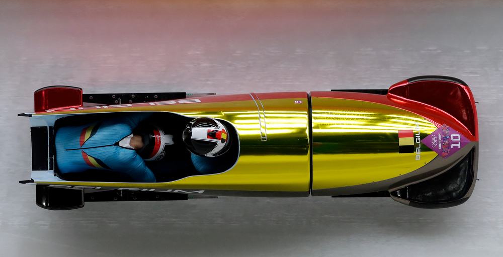 . The team from Belgium BEL-1, piloted by Elfje Willemsen with brakeman Hanna Emilie Marien, take a curve during the women\'s two-man bobsled competition at the 2014 Winter Olympics, Tuesday, Feb. 18, 2014, in Krasnaya Polyana, Russia. (AP Photo/Michael Sohn)