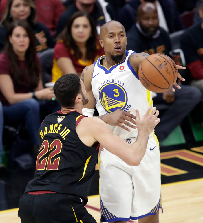 . Golden State Warriors\' David West makes a pass against Cleveland Cavaliers\' Larry Nance Jr. in the first half of Game 3 of basketball\'s NBA Finals, Wednesday, June 6, 2018, in Cleveland. (AP Photo/Tony Dejak)