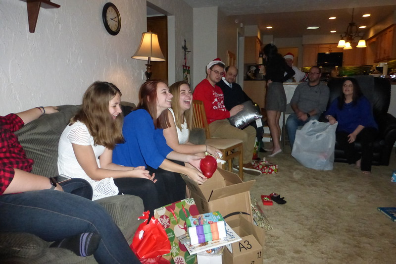 Samantha opening up her gifts.