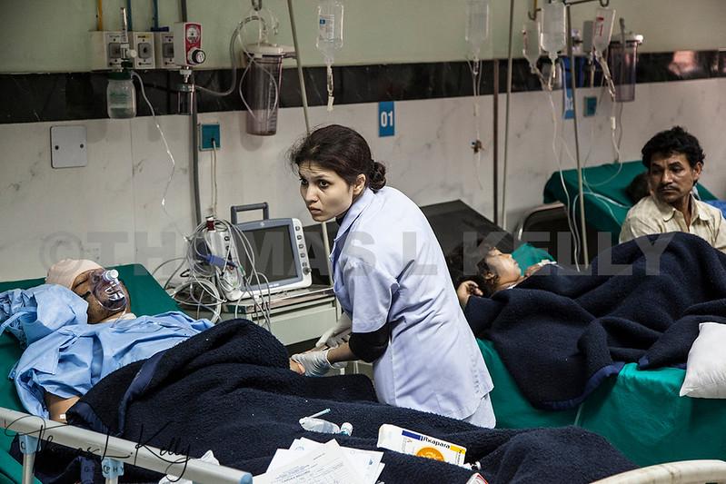 Kathmandu Trauma hospital with nurse caring for post operation victims.