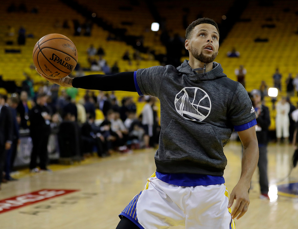 . Golden State Warriors guard Stephen Curry warms up before Game 2 of basketball\'s NBA Finals against the Cleveland Cavaliers in Oakland, Calif., Sunday, June 4, 2017. (AP Photo/Marcio Jose Sanchez)