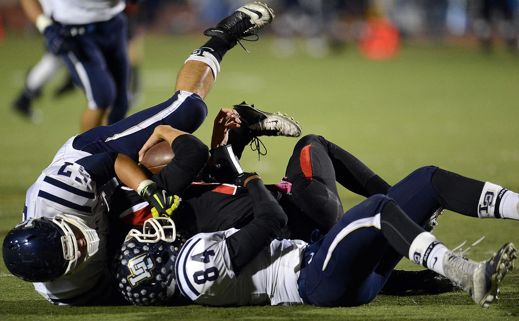 . Los Osos\' Michael West (84) sacks Glendora quarterback Matt Fink (12) along with Los Osos\' Dong Jun Oh (57) in the first half of a prep football game at Citrus College in Glendora, Calif., on Thursday, Oct. 31, 2013.    (Keith Birmingham Pasadena Star-News)